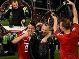 Denmark squad soak Lars Jacobsen with beer