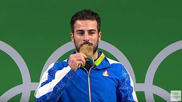 iran-iraq earthquake: olympic champion auctions gold medal for victims