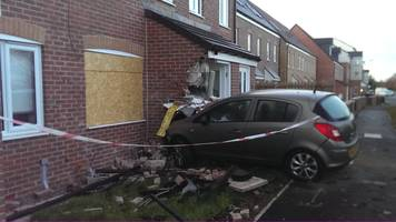 Car crashes into garden wall and house in Ashington