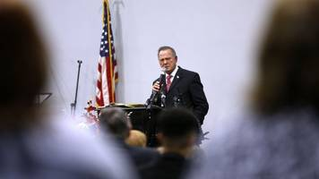 roy moore says he's being 'harassed' by the media