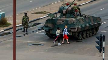 zimbabwe crisis: mugabe 'under house arrest' after army takeover