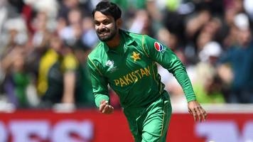Pakistan's Hafeez banned from bowling for third time