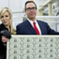 Internet mocks Treasury secretary and wife for posing with a sheet of money