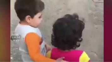 iranian boy leads friend to food video