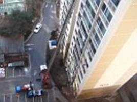 crane used to get belongings from high rise apartment