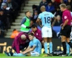 blow for man city as stones limps off versus leicester