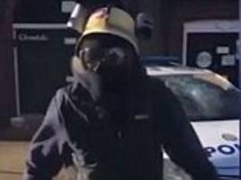 Thug in a gasmask uses a HAMMER to smash up a police car