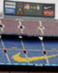 nou camp could be closed if barcelona fans insult spain says la liga president