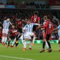 callum wilson nets treble as 10-man bournemouth crush huddersfield