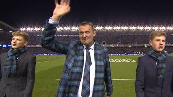 Doddie Weir delivers the match ball with his sons to an emotional Murrayfield