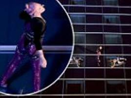 Pink defies gravity in American Music Awards performance