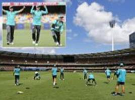 Australia all smiles as they train at the Gabba