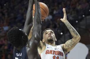 florida struggles from the floor, holds off new hamphire to stay unbeaten