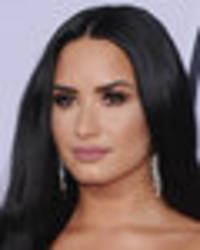 Demi Lovato parades mind-blowing curves in sheer gown