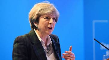 Theresa May urges Stormont talks as Troubles issues divide parties