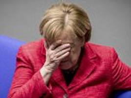 Angela Merkel puts her head in her hands in Bundestag