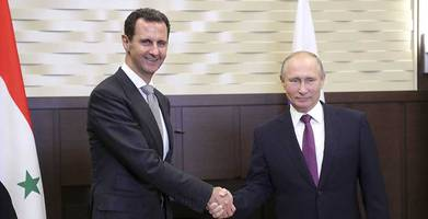 putin holds surprise meeting with assad, will call trump by phone later tuesday