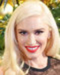 gwen stefani, 48, stuns in see-through dress and fishnets