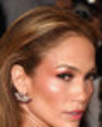 jennifer lopez barely covered in outfit slashed around privates