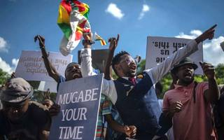 ousted vice president returns to zimbabwe after robert mugabe resigns