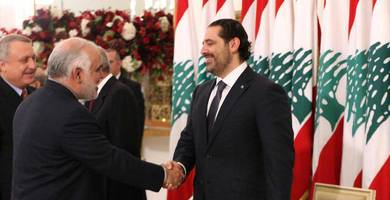 hariri's unresignation as seen in a bizarre photo with the iranian ambassador
