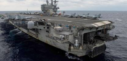 navy plane crashes into pacific off okinawa with 11 aboard; 3 missing