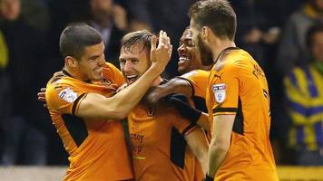 wolves four points clear with 4-1 win over leeds