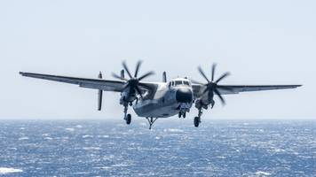 a us navy aircraft carrying 11 people crashed into the ocean