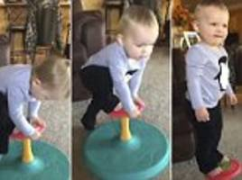 fayetteville toddler balances perfectly on one of her toys
