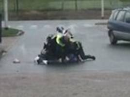 Moment police officers fire warning shot at a knifeman