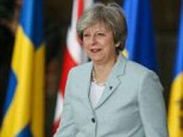may vows to be 'open eyed' about the russian threat