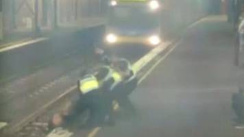 woman dragged from tracks in narrow escape in melbourne
