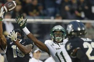 No. 15 UCF stays unbeaten after wild 49-42 win over South Florida