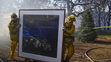California fire burns Bel-Air mansions as spread continues
