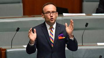 Cheers and a sing-song: Australian MPs back gay marriage