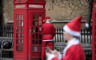 here's why hundreds of santas are swarming the streets of london