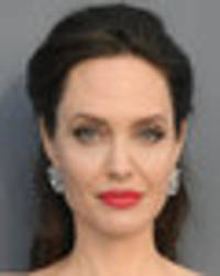 angelina jolie makes sure all eyes are on her in racy thigh-split gown