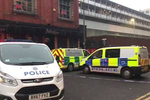 hurst street closed off as man in five hour stand-off on car park roof