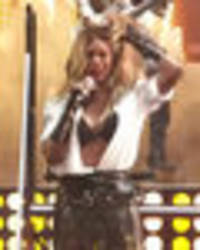 the real dirty diana! laverne cox flaunts cleavage in open shirt performance
