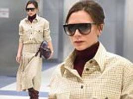 victoria beckham makes a stylish arrival at jfk airport