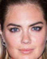 Braless Kate Upton nearly pops out of dress with hole over cleavage
