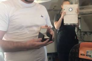 man proposes to girlfriend on easyjet flight to rome at 30,000ft as passengers watch - this is what she said