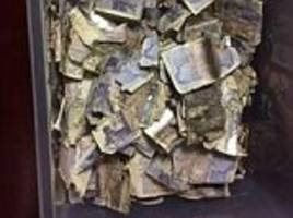 workers who found £7,000 in a bin bag face agonising wait