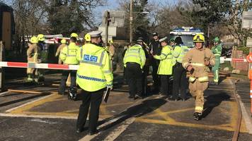 Barns Green level crossing: Two dead after car hit by train