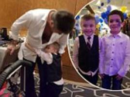 simon cowell gets a hug from cancer-stricken child