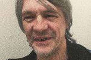 call 999 if you see this man: he's serving a life-sentence for manslaughter and is on the run