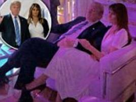 melania trump places her hand on donald's arm in picture