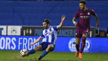 FA Cup: Wigan striker Will Grigg scores a crucial opening goal against Manchester City in the fifth round