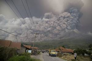 indonesia raises aviation warnings after villages covered in ash by volcano