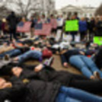 Students stage lie-in outside White House to demand gun control